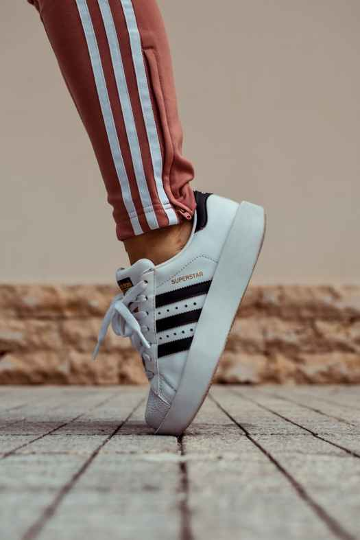 close up photo of adidas shoes